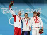 (L-R) Szymon Kolecki of Poland, silver, Ilya Ilin of Kazakhstan, gold, Arsen Kasabiev of Georgia, bronze, receive their medals after winning the men's 94kg weightlifting event.