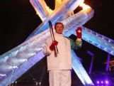 Hockey great Wayne Gretzky lights the Olympic Cauldron during the Opening Ceremony of the 2010 Vancouver Winter Olympics at BC Place on February 12, 2010.