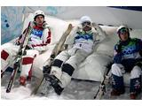 (L-R) Gold medallist Alexandre Bilodeau of Canada sits with Dale Begg-Smith of 