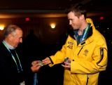 Silver medalist Dale Begg-Smith of Australia visits with guests at a celebration ceremony following his performance in the men's freestyle skiing moguls on February 15, 2010 at the Sheraton Wall Center in Vancouver, Canada.