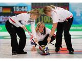 Eve Muirhead (C) of Great Britain and Northern Ireland releases the 