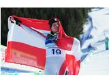Andrea Fischbacher of Austria celebrates with the Austrian flag after 