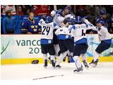 Saara Tuominen #22 (2nd L) is congratulated by teammates at the ice hockey women's bronze medal game between 