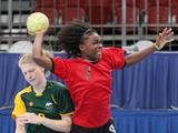 Alice Keighley(#2) of Australia fouls Jocelina Mateta (#3) of Angola but fails to stop her from scoring