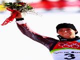 Benjamin Raich of Austria celebrates winning the Gold Medal after finishing first in the Mens Alpine Skiing Giant Slalom competition on Day 10 of the 2006 Turin Winter Olympic Games on February 20, 2006 in Sestriere Borgata, Italy.
