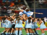 Maria Magdalena Aicega #2 of Argentina is thrown in the air by teammates in celebration after their 3-1 victory over Germany during the women's bronze medal hockey match.