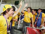 Australia's Jeremy Hayward (extreme left) gives a high five to an Australian supporter on the stands