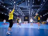 Kazakhstan`s goalkeeper Irina Danilova (#1, left in yellow) gets ready to block a shot by Australia`s Monica Najdovski`s (#20, right with ball) during the Australia versus Kazakhstan women`s preliminary handball match group B, match 4. Kazakhstan beat Australia 45-16.