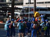 The Australian Olympic Team Mascot, BK, is greeted by school kids while heading to the celebration for 100 days until the Nanjing Youth Olympic Games, at Sydney Harbour on 8 May 2014.