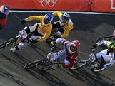 Sam Willoughby (2L) of Australia and Maris Strombergs (4L) of Latvia lead the field out of the berm during the Men's BMX Cycling Quarter Finals on Day 13.