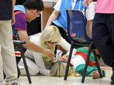 Medics attend to Belarus shooter Kseniya Faminykh she collapsed and fainted during her second series of qualification round of the 10m Air Pistol Girls Competition. She failed to complete the event.