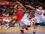 Tatyana Troina #13 of Belarus drives for a shot attempt against Zhang Hanlan #6 and Chen Xiaoli #12 of China during their quaterfinal women's basketball match.