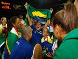 Brazil head coach Jose Roberto Guimaraes celebrates with his team after they defeated the United States during the women's gold medal volleyball game.