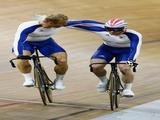 Silver medalist Jason Kenny (R) of Great Britain congratulates Gold medalist Chris Hoy of Great Britain after the Men's Sprint Finals in the track cycling event.
