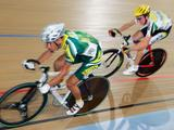 Ivano Siebritz of South Africa (L) and Cameron Meyer of Australia in action during the men's 25km points race final during day 3  at the Dunc Gray Velodrome, January 22