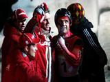 Gold medal winner Duff Gibson of Canada celebrates with team mates after the Mens Skeleton Single Final.