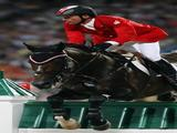 Eric Lamaze of Canada and Hickstead jump a fence during the Individual Jumping Final - Round A held at the Hong Kong Olympic Equestrian Venue in Sha Tin.