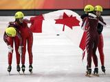Team Canada celebrates after winning the silver medal in the women's 3000m final speed skating.