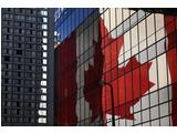 The distinctive Canadian flag is reflected on a building in downtown Vancouver.