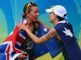 Bronze medallist Emma Moffatt (R) and gold medallist Emma Snowsill of Australia celebrate after the women's triathlon event at the Triathlon Venue on Day 10 of the Beijing 2008 Olympic Games on August 18, 2008 in Beijing, China.
