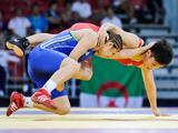 China's Yuan Yuan (top right) wrestles Azerbaijan's Patimat Bagomedova in the 52kg gold medal match. Azerbaijan won.
