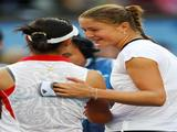 Dinara Safina of Russia is congratulated by Li Na of China after winning their women's singles semifinal.