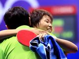 Gold medaslist Gu Yuting of China hugs her coach after winning the women's singles of table tennis final