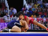 Colombia's Yerzon Hernandez (top) does a headlock on Turkey's Mehmet Ali Daylak. Mehmet Ali Daylak won bronze.