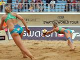 Natalie Cook digs deep at the Shanghai Grand Slam with teammate Tamsin Hinchley close beside her.