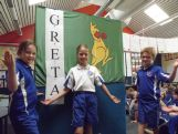 Esperance students hang the BK Flag in preparation for their Chat to a Champ with Greta Small.