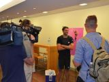 Olympic long jump medallist Mitchell Watt being interviewed by media at the IGNITE session in Brisbane.
