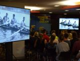 Athletes watch highlights of Australia's Olympic history from Athens 1896, at the IGNITE session in Brisbane.
