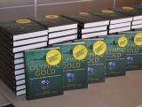 Copies of Olympic Gold, written by Robin Poke and Kevin Berry, for athletes to collect at IGNITE Brisbane.