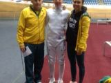 Youth Olympic athlete Max Esposito (centre) poses for a photo with his Olympian father and sister, Daniel and Chloe.