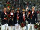 The victorious German Team of (L-R) Peter Thomsen, Andreas Dibowski, Hinrich Romeike, Ingrid Klimke and Frank Ostholt after winning The Team Eventing Gold Medal.
