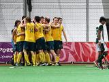 Australia's boys' hockey team (left) celebrate their win over Pakistan. Australia won the gold medal with a 2-1 score. Photo: