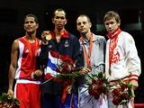 <br />(L-R) Silver medalist Andris Laffita Hernandez of Cuba, gold medalist Somjit Jongjohor of Thailand and bronze medalists Vincenzo Picardi of Italy and Georgy Balakshin of Russia stand on the podium during the medal ceremony for the Men's Fly (51kg) Final Bout held at Workers' Indoor Arena.