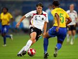 Annike Krahn (L) of Germany and Renata Costa of Brazil compete for the ball during the Women's Semi Final match between Brazil and Germany at Shanghai Stadium.