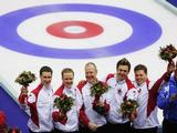 (L-R) Brad Gushue, Mark Nichols, Russ Howard, Jamie Korab and Mike Adam of Canada celebrate winning gold after the Gold medal match of the men's curling between Finland and Canada.