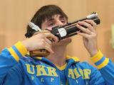 Denys Kushnirov of Ukraine kisses his pistol after winning the 10m Air Pistol Boys Final Competition. He won the gold with a score of 676.3 beating Brazilian shooter Almeida Felipe's 670.