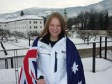 Greta Small poses with the Australian flag at the announcement of the 2012 Australian Winter Youth Olympic Team flagbearer.