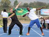Prince Harry poses with Usain Bolt at the Usain Bolt Track at the University of the West Indies on March 6, 2012 in Kingston, Jamaica. Prince Harry is in Jamaica as part of a Diamond Jubilee Tour, representing Queen Elizabeth II, taking in Belize, the Bahamas, Jamaica and Brazil.