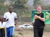Prince Harry races Usain Bolt at the Usain Bolt Track at the University of the West Indies on March 6, 2012 in Kingston, Jamaica. Prince Harry is in Jamaica as part of a Diamond Jubilee Tour, representing Queen Elizabeth II, taking in Belize, the Bahamas, Jamaica and Brazil.