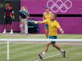 Lleyton Hewitt makes a shot in the mixed doubles quarter finals against Laura Robson and Andy Murray of Great Britain.