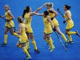 Jade Close of Australia high fives Anna Flanagan as she celebrates with team mates after scoring during the Women's Hockey match between Australia and South Africa on Day 8.