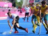 Christopher Zeller of Germany competes with Christopher Ciriello of Australia during the Men's Hockey Semi Final match between Australia and Germany on Day 13