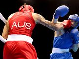 Egor Mekhontcev of Russia (R) in action with Damien Hooper of Australia during the Men's Light Heavy (81kg) on Day 8