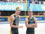 Jamie Huggett and Brendan Sexton pose on the beach before the men's race.