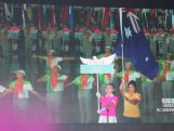 Tiana Penitani on the big screen as the flag bearer for the Australian Youth Olympic Team