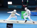 Ned Fitzgerald of Australia strikes during the Men's Individual Foil on day three of the Nanjing 2014 Summer Youth Olympic Games at International Expo Centre on August 19, 2014 in Nanjing, China.